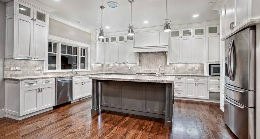Awesome Varnished Wood Flooring White Kitchen Themed