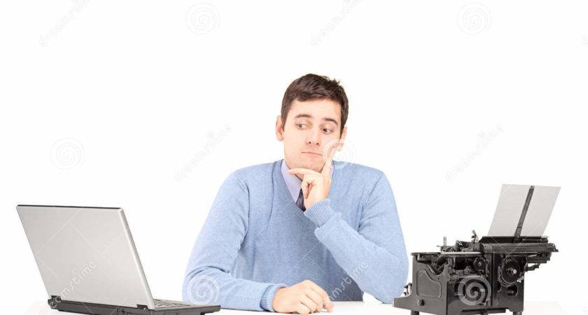 Confused Man Sitting Desk Laptop Typing