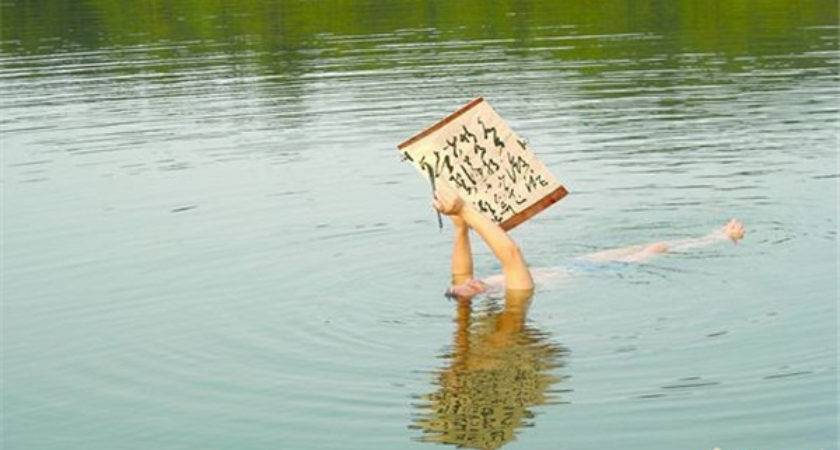 Man Writes Calligraphy While Floating Water China