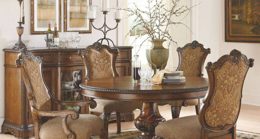 Pemberleigh Extendable Round Oval Dining Room Set