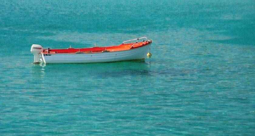 Red White Boat Floating Crystal Clear Water
