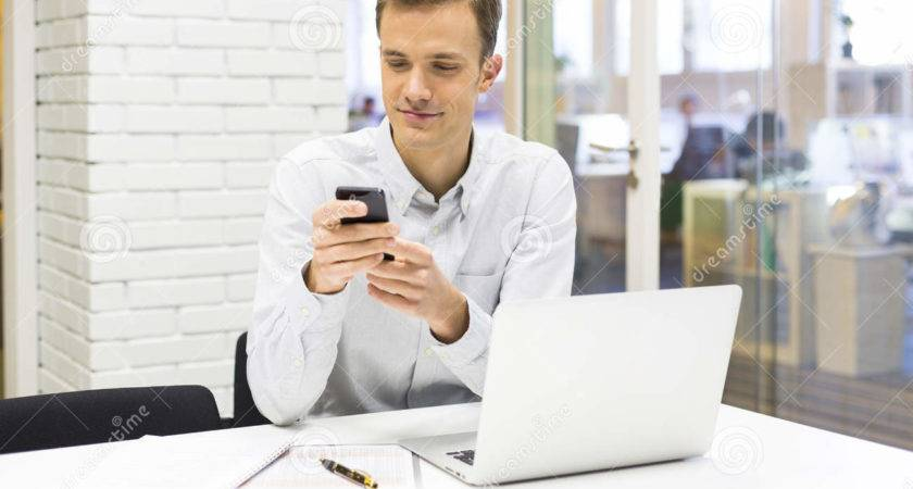 Young Businessman Mobile Phone Office Sms Message